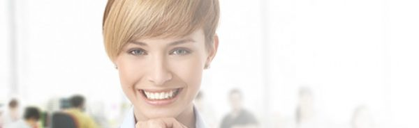 Happy young woman at office